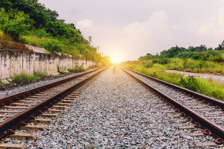 Railroad Double tracks in the setting sun in Chonburi, Thailand.
