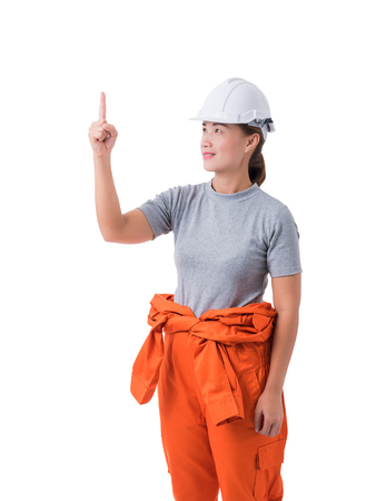 portrait of a woman worker in Mechanic Jumpsuit with helmet and Pointing up fingers isolated on white background clipping path