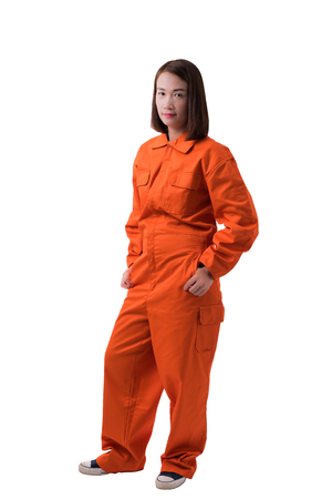 Full body portrait of a woman worker in Mechanic Jumpsuit isolated on white background with clipping path