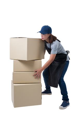 Full Body portrait of delivery woman in Gray shirt and apron. she lifting heavy weight boxes against having a backache isolated on the white background with clipping path