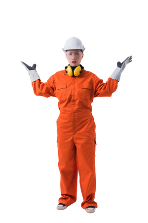 Full body portrait of a woman worker in Mechanic Jumpsuit with helmet earmuffs Protective gloves and Safety goggles isolated on white background clipping path