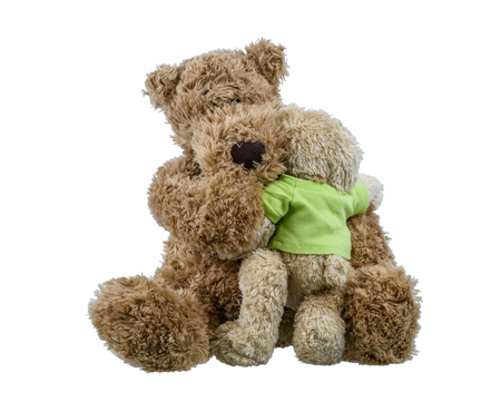 bear baby doll sitting on mother bear doll and hugging each other showing love and concern in the family isolated on white background