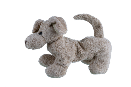 Cute dog doll isolated on white background. Children's toys and gifts for peoplee all ages. Side view