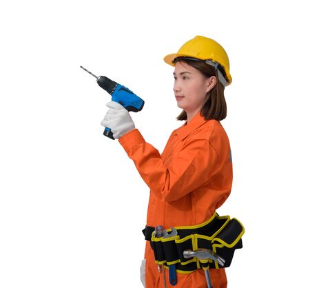 construction woman workers wearing Orange Protective clothes, helmet hand holding electric drill with tool belt isolated on white background with clipping path