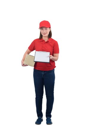 Smiling delivery woman in red uniform giving parcel boxes and clipboard, isolated on white background with clipping path. delivery service, mail, logistics, people and shipping courier service concept