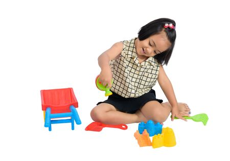 Cute Happy little child playing beach toys isolate on white background with clipping path