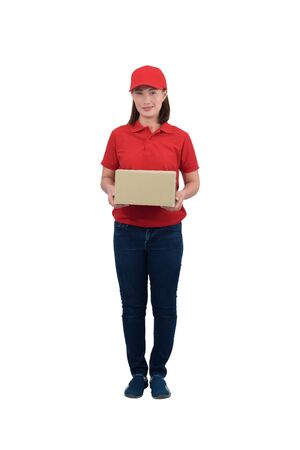 Smiling delivery woman in red uniform giving parcel boxes, isolated on white background with clipping path. delivery service, mail, logistics, people and shipping courier service concept