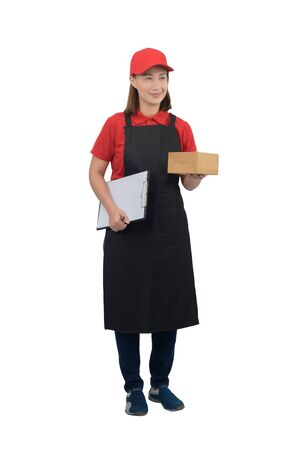 Smiling delivery woman in red uniform with apron giving parcel boxes and clipboard isolated on white with clipping path. delivery service, mail, logistics, people and shipping courier service concept