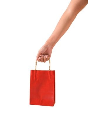 Female hand holding blank red papaer shopping bags isolated on white background