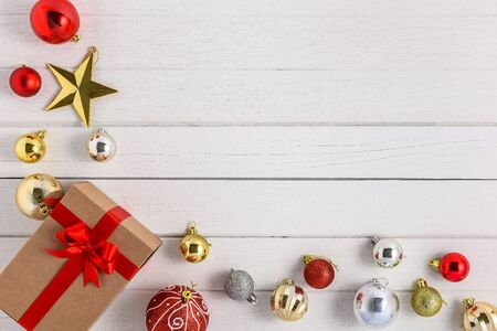 Gifts boxes with festive ribbons and christmas ornament on white wooden background. holiday, giving, new year, christmas, birthday, celebration, anniversary with copy space