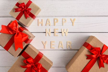 HAPPY NEW YEAR Wood Text For the new year with gift box on white wooden background Stok Fotoğraf