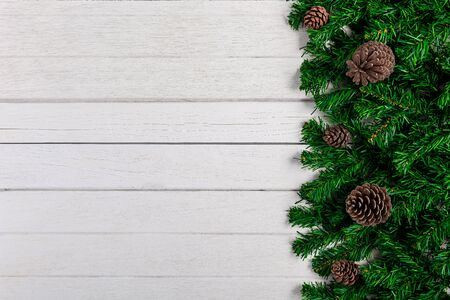 Fir branches and Pine cones on white wooden board. Christmas or New year background Stok Fotoğraf