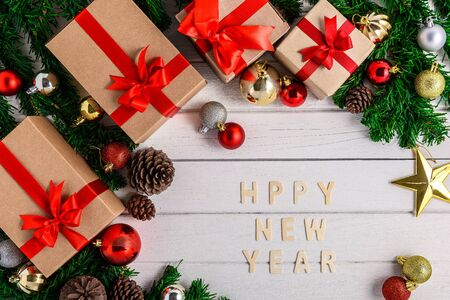 Christmas fir tree with decoration on white wooden board. Top view with copy space. Christmas or New year background Stok Fotoğraf - 133544015