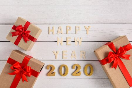 HAPPY NEW YEAR 2020 Wood Text For the new year with gift box on white wooden background Stok Fotoğraf - 133089750