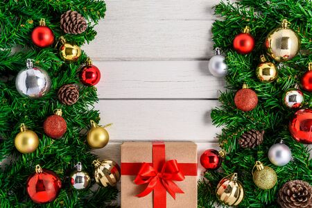 Christmas fir tree with decoration on white wooden board. Top view with copy space Stok Fotoğraf - 133544030