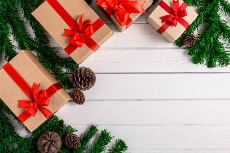 Christmas fir tree with decoration on white wooden board. Top view with copy space Stok Fotoğraf - 133544063
