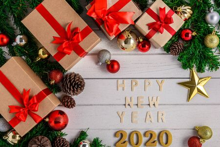 Christmas fir tree with decoration on white wooden board. Top view with copy space. Christmas or New year 2020 background