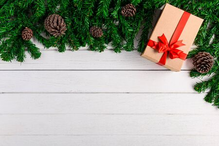 Christmas fir tree with decoration on white wooden board. Top view with copy space Stok Fotoğraf
