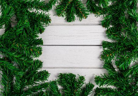 Fir branches on white wooden board. Christmas or New year background Stok Fotoğraf