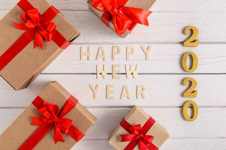 HAPPY NEW YEAR 2020 Wood Text For the new year with gift box on white wooden background Imagens