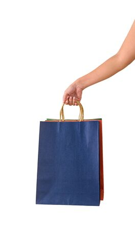 Female hand holding blank colorful papaer shopping bags isolated on white background with clipping path