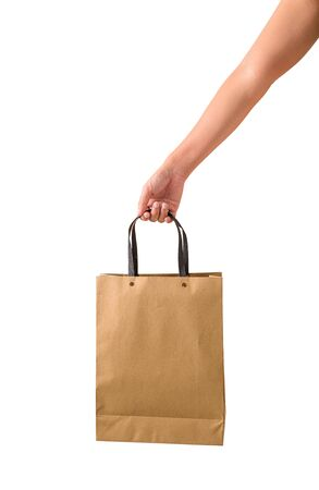Female hand holding blank brown papaer shopping bags isolated on white background with clipping path Stok Fotoğraf