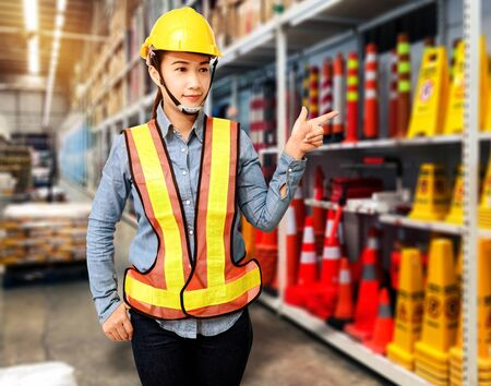 Portrait of Female staff warehouse operator with Blurred the background of safety sign on product shelf in Construction material store Stok Fotoğraf