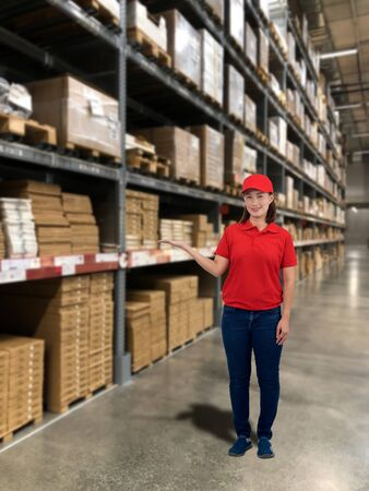 Woman operator in uniform and product shelf with Blurred the background of the warehouse storage