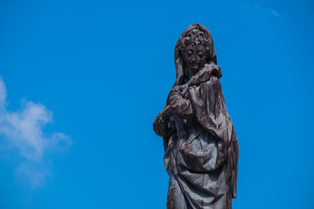 statue black woman have face so sad in clear blue sky on summer