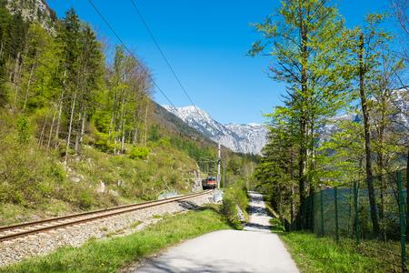 narrow gauge railroad: Railroad tracks have train on railroad. The narrow-gauge railway along the ridge in clear blue sky day on summer
