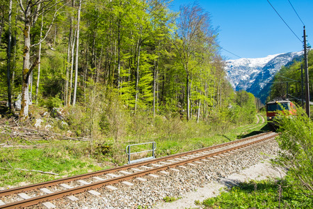 Railroad tracks have train on railroad. The narrow-gauge railway along the ridge in clear blue sky day on summer
