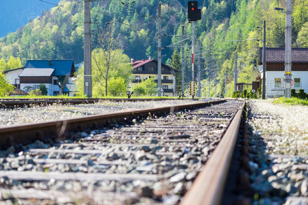 chernobyl: The railway through the Obertraun village in clear blue sky on summer Austria.