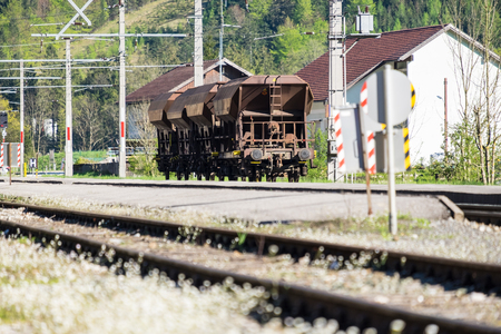 Freight train coupling and bogies on railroad track, background mountain