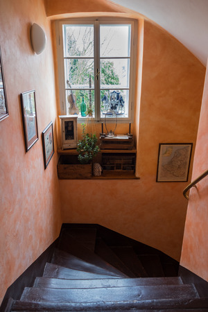 luxury apartment: Stairs in the house have picture on orange wall