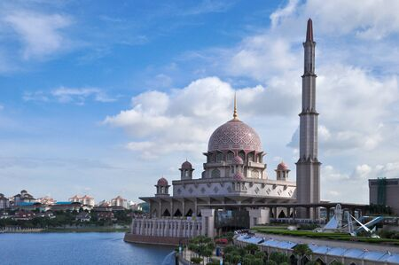 modern mosque riverside in blue sky day Stock Photo