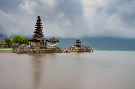 Pura Ulun Danu temple panorama at cloudy day essay on a lake Bratan, Bali, Indonesia
