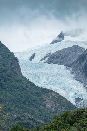 franz: The storm is coming at Top of part of Franz Josef glacier, New Zealand Stock Photo