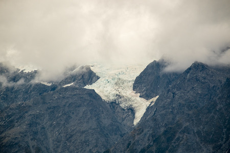 The storm is coming at Top of part of Franz Josef glacier, New Zealand Stock Photo
