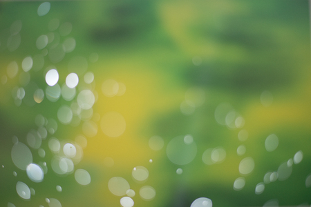 Dark green Bokeh Background. The background with bokeh. Abstract texture. Color circles. Blurred. Stock Photo
