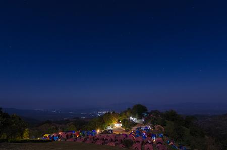 Iluminated tent against mountain at moon night, Chiang Mai,Thailand