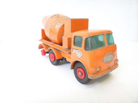 metalic orange toy truck on white background old photo