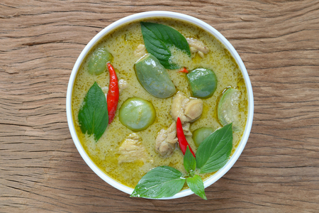 Thai food,green curry with chicken on wood background