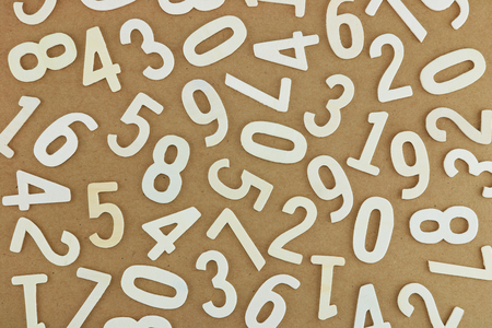 Small wood number one to nine on kraft paper texture. Number concept