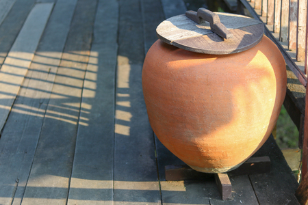 Big earthen jar in Thai style house