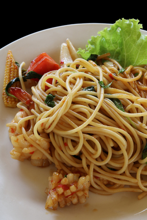 Spaghetti with spicy mixed seafood close up