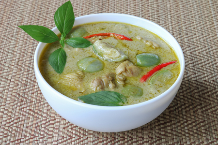 Thai food,green curry chicken on reed mat background.The most popular dishes in restaurant and family of Thailand
