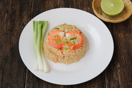 Fried rice with shrimp on wood background.Thai style call