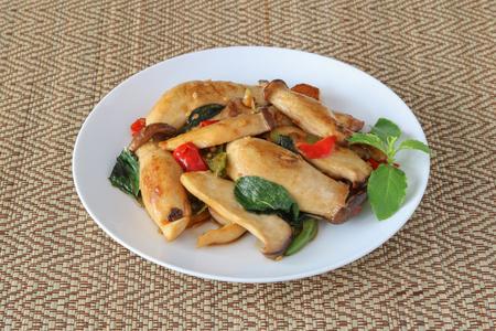 Thai food,stir fried king oyster mushroom ( Pleurotus Eryngii ) on reed mat sheet
