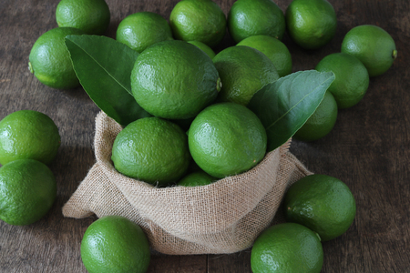 Fresh limes close up on wood background