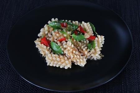 Thai food,stir fried squids with basil close up (Pad Ka Prao Pra Muek).This popular Thai dish serve with steamed rice . Archivio Fotografico